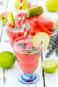 Fresh squeezed juice with watermelon,lime and pear.Selective focus on the first glass